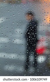 a man and water drop on window glass