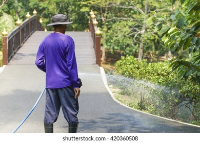 A man watering the garden.