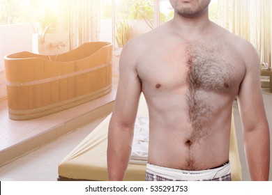man waxing his chest to depilate hair half body in relax spa