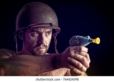 man wear army helmet and hold little toy gun