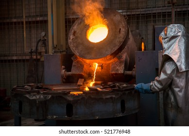 The man is wear protective heat ,He doing production control Iron and steel industry