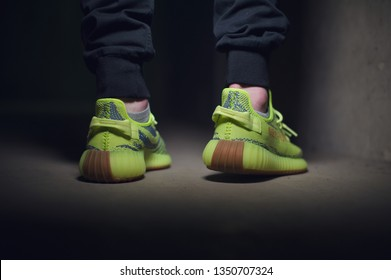 e37ada08c A man wearing Adidas Yeezy Boost 350 v2 Sply semi frozen yellow sport shoes  shot on