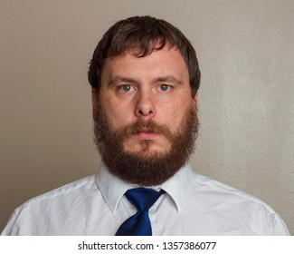 Man wearing with a beard with a nice dress shirt and tie
