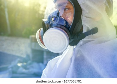 Man wearing big gas mask against Coronavirus Covid-19 contamination. Lockdown for SARS-CoV2 virus pandemic. Post apocalypse specialist breathing in anti-virus and radiation gas mask. Doomsday clothing