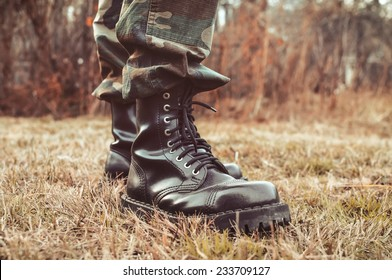man wearing black leather boots