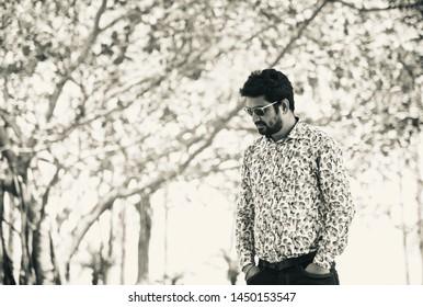 Man wearing black sunglass standing around a place