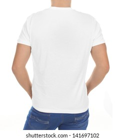 Man wearing blank t-shirt isolated on white background with copy space