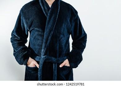 04cbfeff0e A man wearing a blue bathrobe
