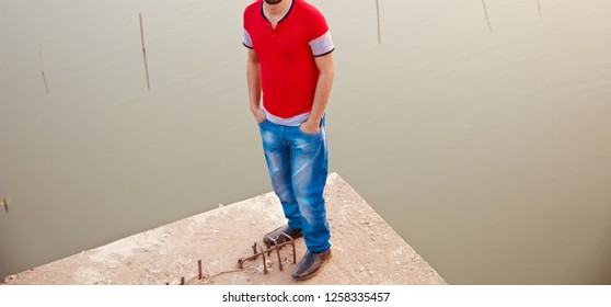 Man wearing blue jeans standing in a place unique photo