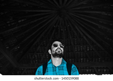 Man wearing blue shirt standing in a place unique photo