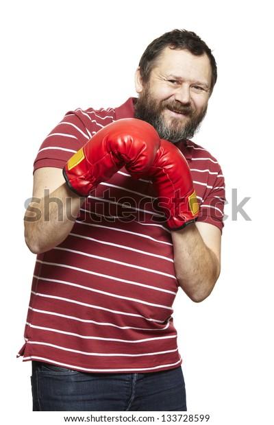 Man wearing boxing gloves smiling on white background