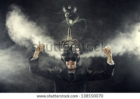 Man wearing a brain-control helmet, celebrating with open arms