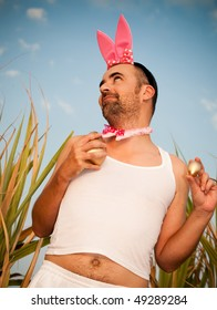 Man Wearing Bunny Hat With Golden Eggs In The Hands