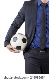 Man wearing business suit and holding soccer ball, isolated over white background