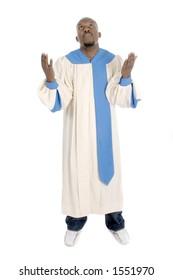Man wearing a choir robe looking upward in worship.