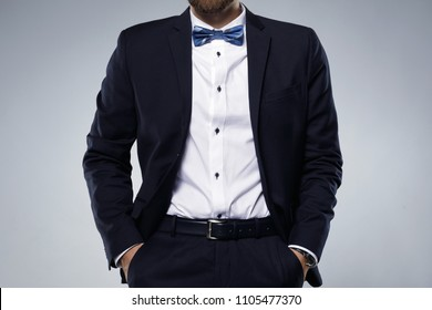 Man wearing classic navy blue suit and bow tie
