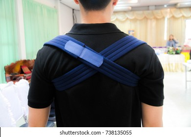Man wearing clavicle brace for immobilize shoulder ,clavicle support for fracture clavicle,(Donus sprint)subject is bright and blurred