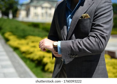 man wearing elegant clothes - shirt and jacket tailor made withhandkerchief