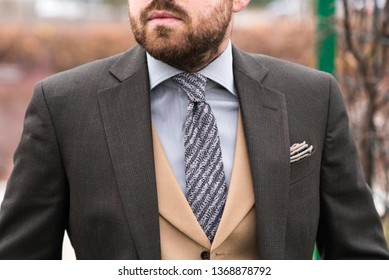 man wearing elegant clothes - tie, shirt and jacket tailor made suit