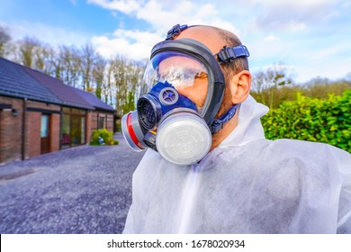 Man wearing full-Face Respirator protective gas mask against virus, radiation, bacteria and dust. Professional mask shortage during Covid-19 Coronavirus SARS-CoV-2 pandemic worldwide outbreak
