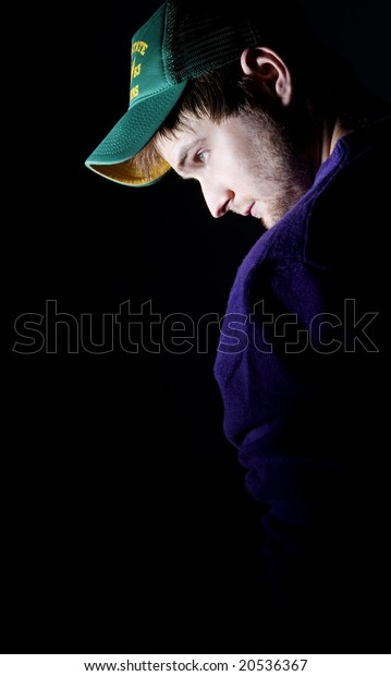 man wearing green hat and purple top