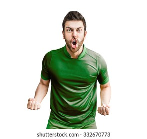 Man wearing green uniform celebrates on white background