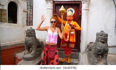 Man wearing Hanuman costume and tourist girl