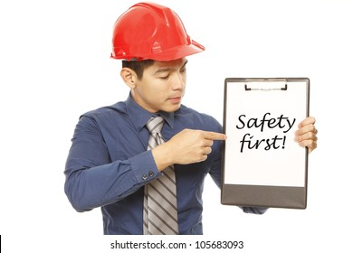 Man wearing a hard hat highlighting the importance of safety in the workplace. (Message on clipboard can be edited and replaced.)
