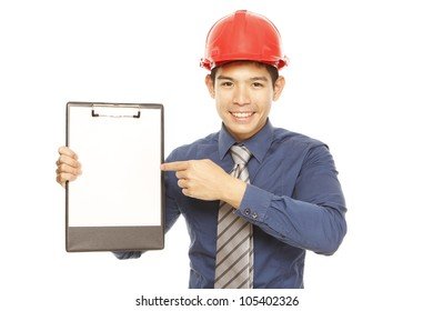 Man wearing a hard hat pointing at an empty clipboard