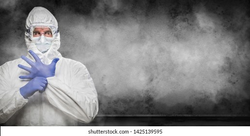 Man Wearing Hazmat Suit and Goggles In Smokey Room Banner with Copy Space.