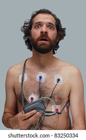 A Man Wearing a Heart Halter Monitor, Looking Afraid