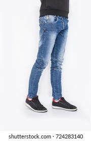 Man wearing jeans and shoes isolated on white background