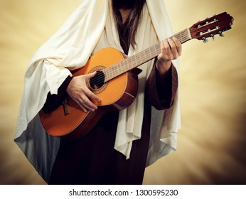 Man wearing Jesus Christ costume and plays guitar. Religious music concept.