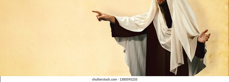 Man wearing Jesus Christ costume pointing with hand and finger to the side.
