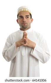 Man wearing kurta robe and topi cultural clothing - thinking and looking up.   White background.
