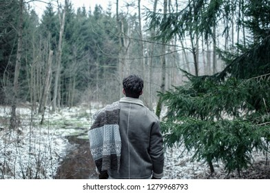 Man wearing leather jacket in the frozen forest