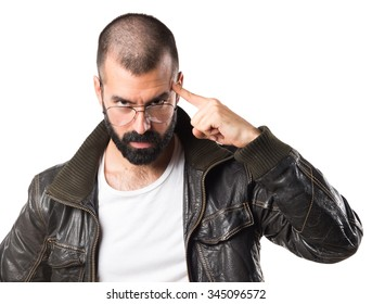 Man wearing a leather jacket thinking