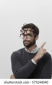 Man wearing many pairs of glasses, portrait