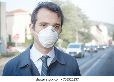 Man wearing mask against smog air pollution
