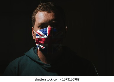 man wearing mask with flag for protection of corona virus covid-19 SARS-CoV-2
