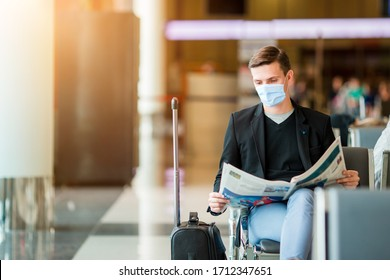 Man wearing a mask for prevent virus in international airport lounge waiting for flight aircraft. Protection against Coronavirus and gripp