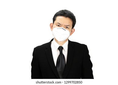 Man wearing mask protect fine dust in air pollution environment - people with protection equipment for air pollution concept
