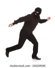 Man Wearing Mask Running Over White Background