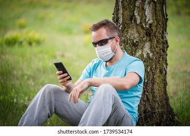 Man wearing a mask with smartphone