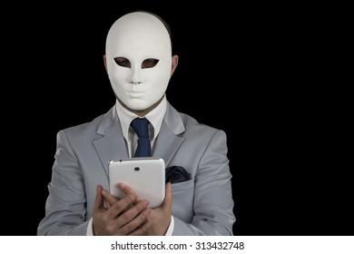 man wearing mask texting on smart phone,