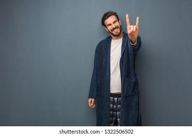 Man wearing pajama reaching out to greet someone