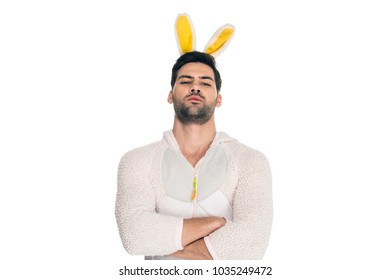 Man wearing rabbit costume and standing with crossed arms isolated on white, easter concept