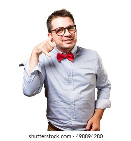 Man wearing a red bow tie. Doing a phone gesture.