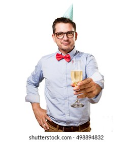 Man wearing a red bow tie and party hat. Offering a champagne glass.