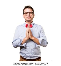 Man wearing a red bow tie. Praying.
